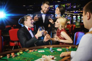 Happy people celebrating their win after successful game in the casino